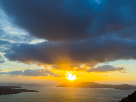 A sunset at Fira town, with view of caldera, volcano