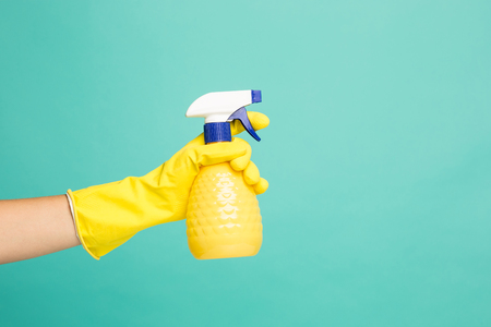 Close up picture of a house-cleaning spray on a blue background