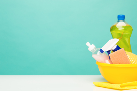 Various bottles with cleaning supplies on colored background Stock Photo