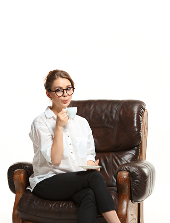 couch: attractive businesswoman have a coffee break