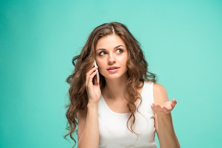 The portrait of disgusted woman with mobile phone Stock Photo