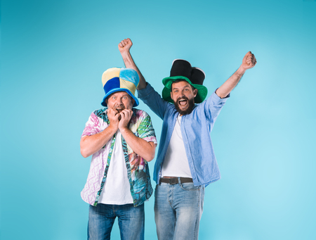 The two football fans over blue