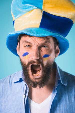 The football fan over blue Stock Photo