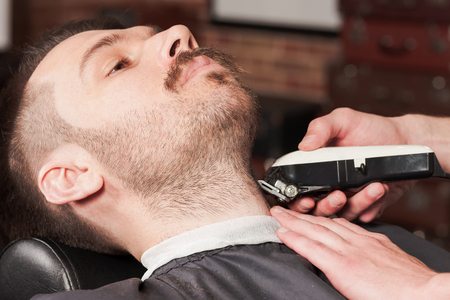 Hipster client visiting barber shop