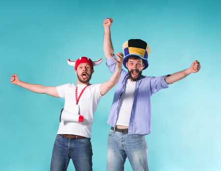 Two Excited Male Friends Celebrate Watching Sports Stock Photo