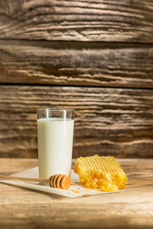 drizzler: Sweet honeycomb on wooden table Stock Photo