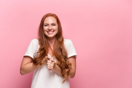 Portrait of young woman with happy facial expression Stock Photo