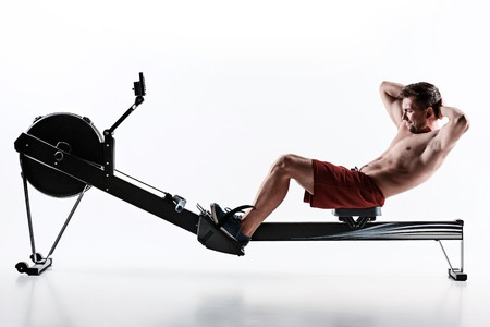 Man Using A Press Machine In A Fitness Club. Stock Photo