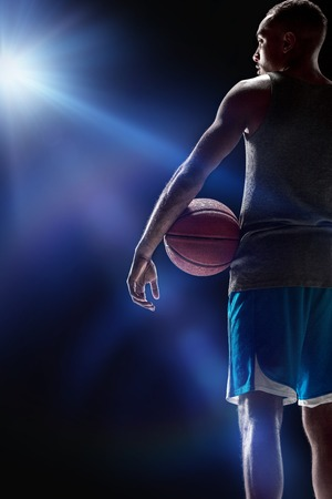 The portrait of a basketball player with ball
