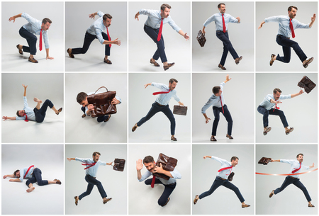 Businessman running with a briefcase on gray background Stock Photo