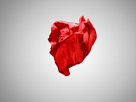 Smooth elegant transparent red cloth separated on gray background. Reklamní fotografie