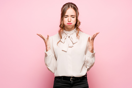 The serious frustrated young beautiful business woman on pink background Фото со стока - 87047732
