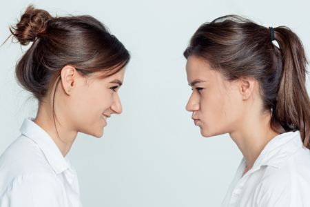 Studio portrait of female twins