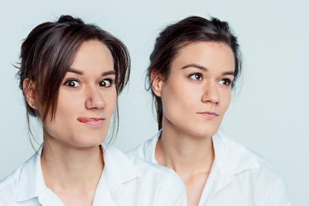 identical: Studio portrait of female twins