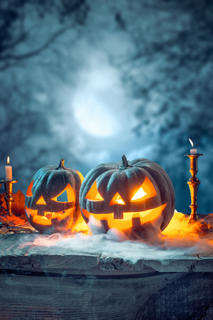 Halloween pumpkins on blue background Imagens