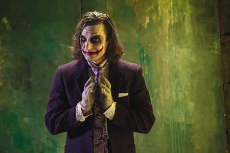 Bloody Halloween theme: crazy joker face Фото со стока - 87962224