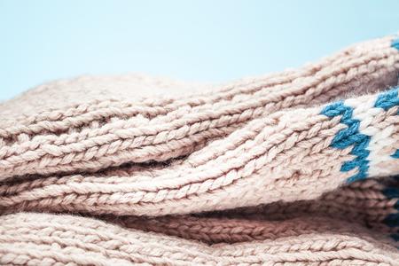 large folds on the warm knit light scarf Stock Photo