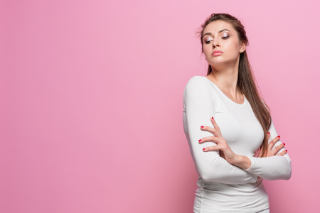 The young womans portrait with proud and arrogant emotions Stock Photo