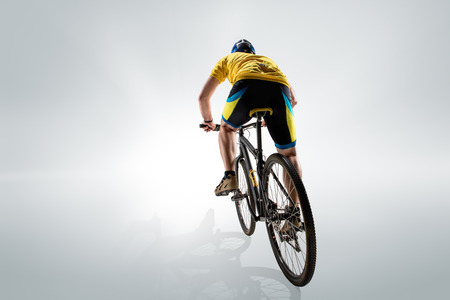 The bicyclist on gray, studio shot.