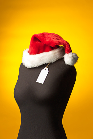 The empty dummy, sale price tag hanging from the button hole. Stock Photo
