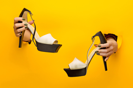 Brown woman shoe on hand isolated Stock Photo