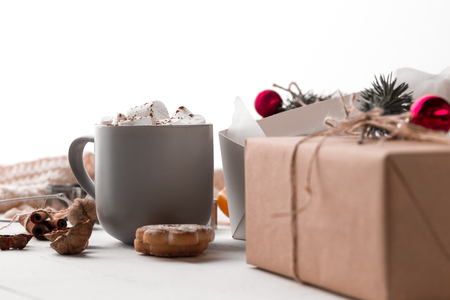 The winter composition. The gifts and cup with marshmallow Stock Photo