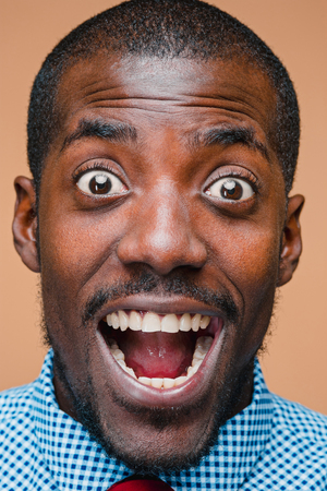 The portrait of handsome young surprised black african man Stock fotó
