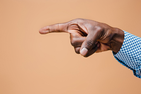 Black male hand point finger. Hand gestures - man pointing on virtual object