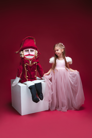 The beauty ballerina standing with nutcracker Stock Photo