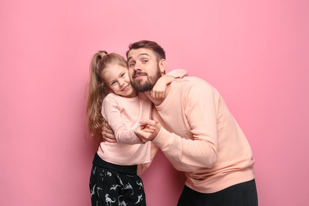 Young father with his baby daughter