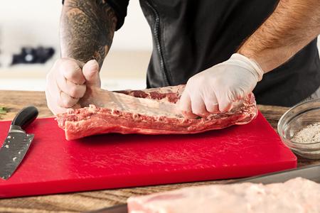 Man cooking meat steak on kitchen