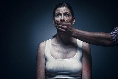 Man covering young womans mouth Standard-Bild