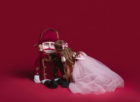 The beauty ballerina who holding a nutcracker Stock Photo