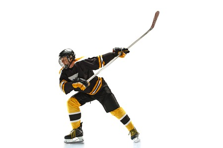 one caucasian man hockey player in studio silhouette isolated on white background Stock Photo