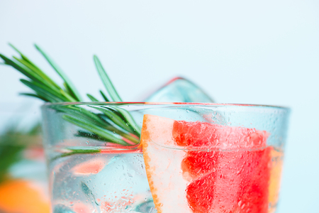 closeup of a cape cod cocktail or vodka cranberry on a blue background