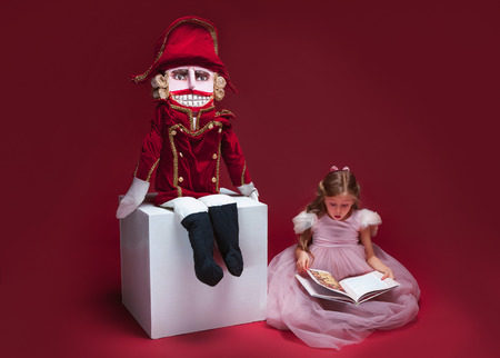 The beauty ballerina sitting with nutcracker