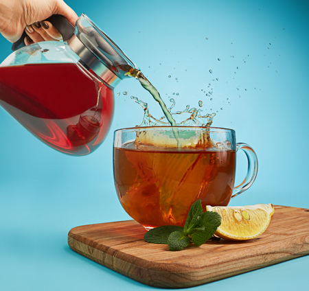 The herbal tea on a blue background