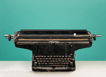 Retro old typewriter with paper on wooden table