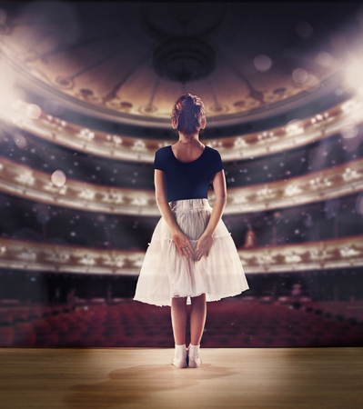 Baby girl dreaming a dancing ballet on the stage. Childhood concept.