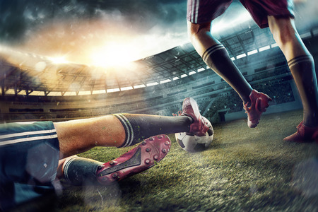 The soccer football players at the stadium in motion Stock Photo
