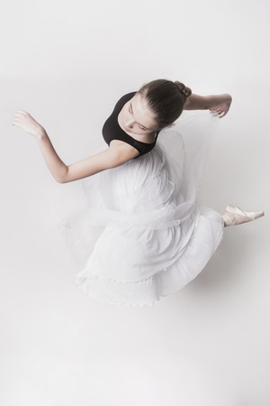 The top view of the teen ballerina on white background