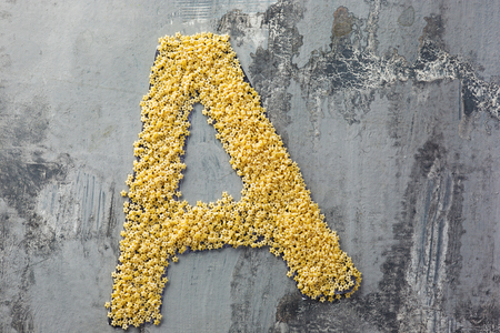 Alphabet made of pasta. Letter A