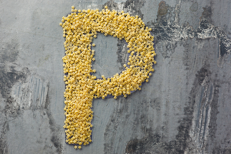 Alphabet made of pasta. Letter P