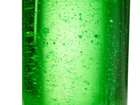 abstract background : bubble of sparkling water soda on the green glass bottle with gradient light Stock Photo