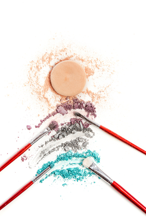 The colored eyeshadow crushed on white close up for background Stock Photo