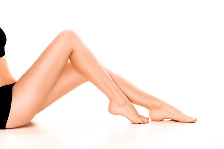 Beautiful smooth and shaved womans legs. Stock Photo