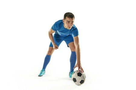Professional football soccer player with ball isolated white background Stock Photo