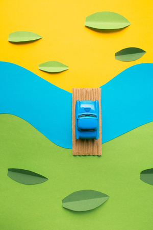 Vintage miniature car in trendy color, travel concept