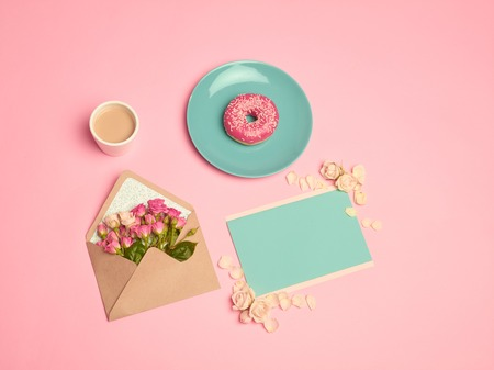 The Love letter concept on pink table with envelope