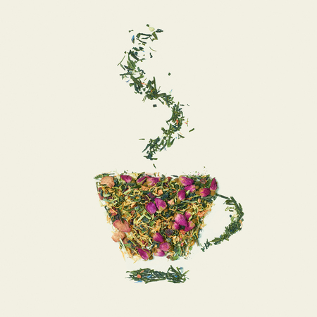 Tea leaf with flowers and fruit word tea on white background, top view